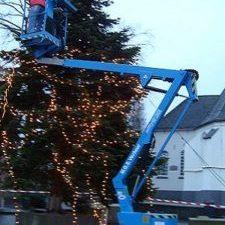 Knikarm hoogwerker kerstboom